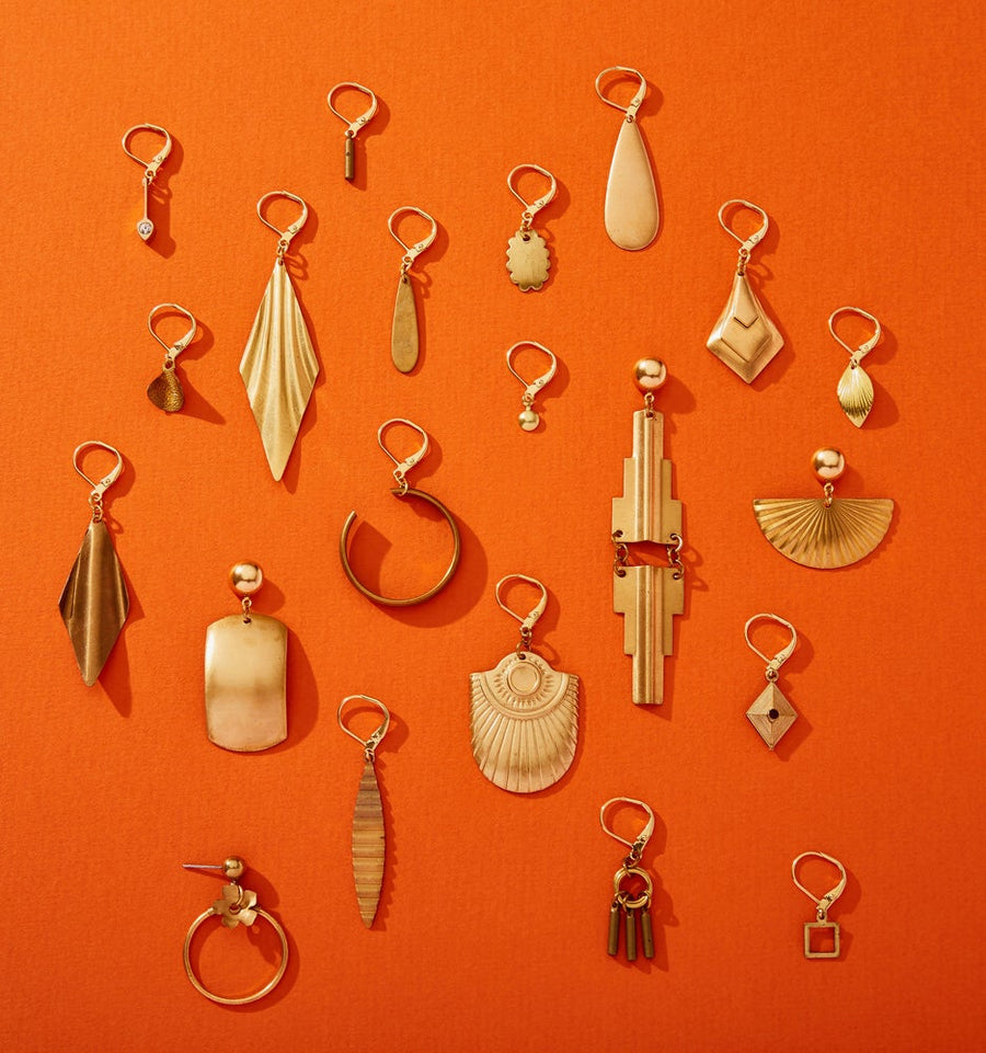 Brass earrings in all different shapes and sizes.
