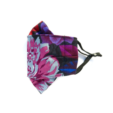 Folded Non-Surgical Reusable Fabric Mask with adjustable ear loops. Made with three layers in central panel. Handmade in Toronto, Canada.