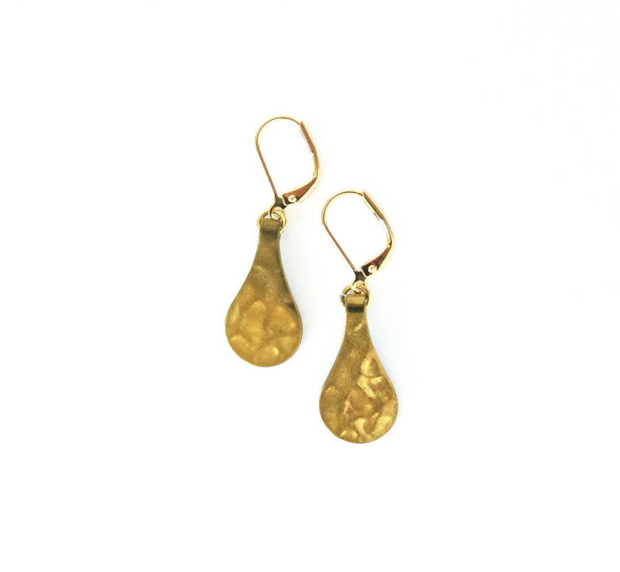 Fragment Earrings feature hammered brass drops hang from lever back ear wires.