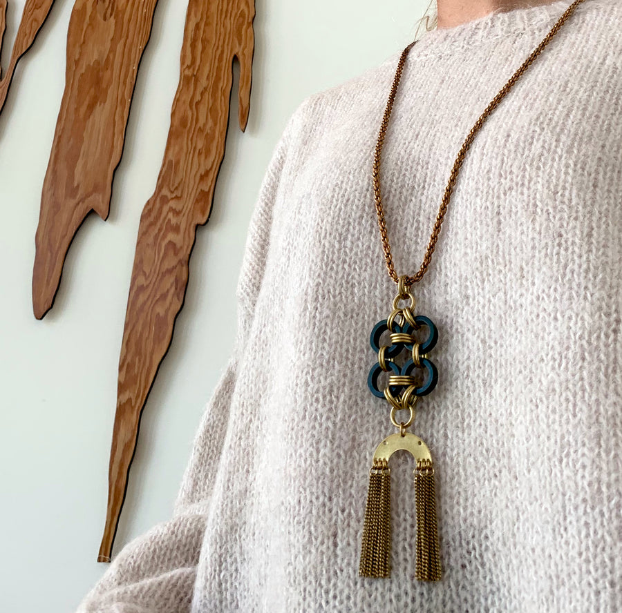 Close up on Good Fortune Necklace by MoonRox - long necklace with rope chain and pendant that combines vintage Bakelite and brass fringe.
