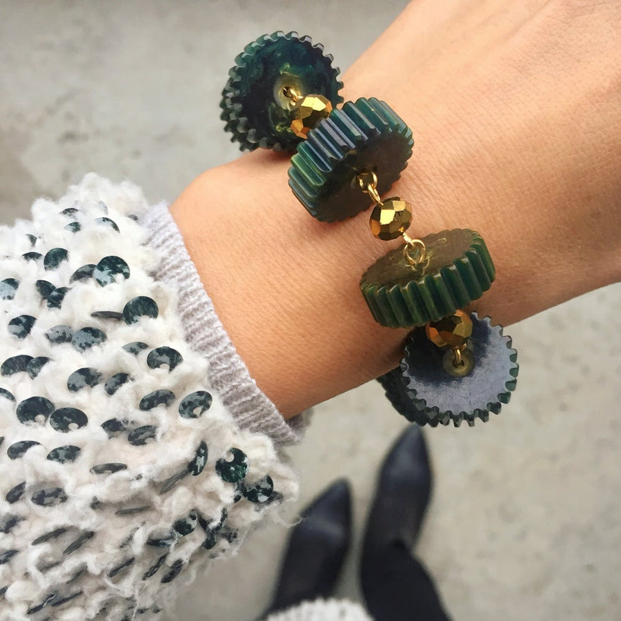 Good Times Roll Bakelite Bracelet by MoonRox shown on wrist - Bakelite slices are hand wired to metallic crystal beads