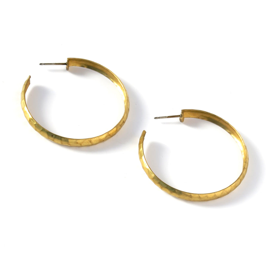 The Ground Control Hoops are made of brass with a hammered or mottled texture.
