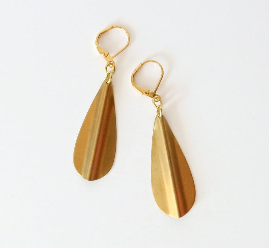 Ridge Earrings feature brass drop shaped charms with a raised ridge down the centre.