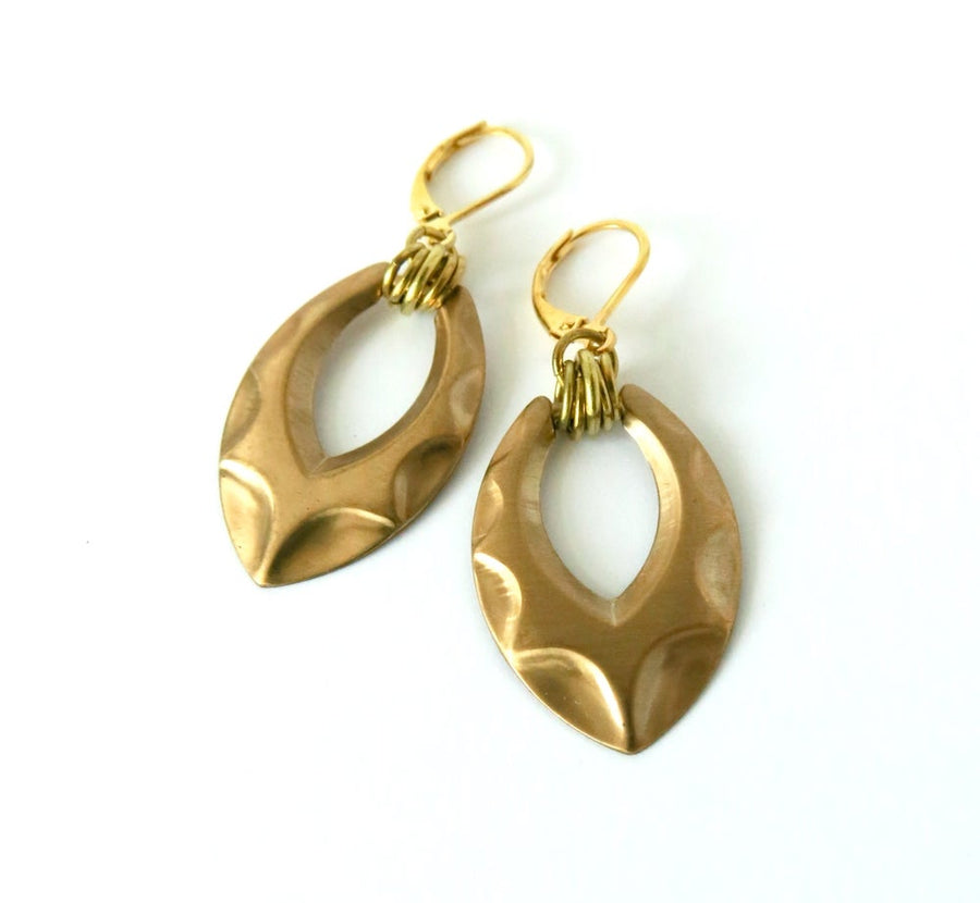 Shadow Earrings by MoonRox are dangly brass charm earrings with raised pattern and multiple loops hung from lever-back ear wires.