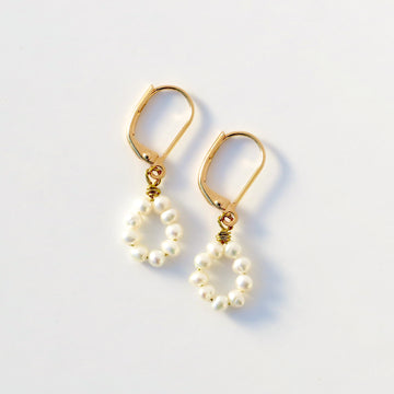The Illuminated Earrings feature hand wired freshwater pearls.