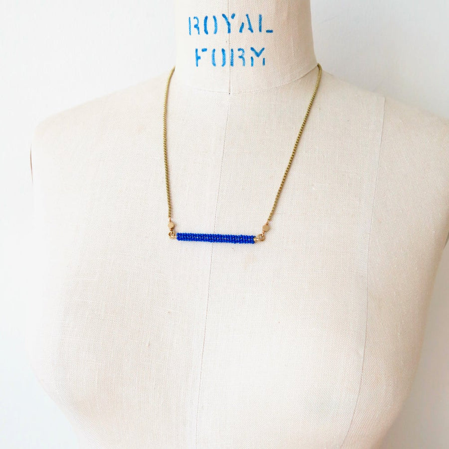 In Perfect Balance Necklace combines delicate glass beads with brass chain.