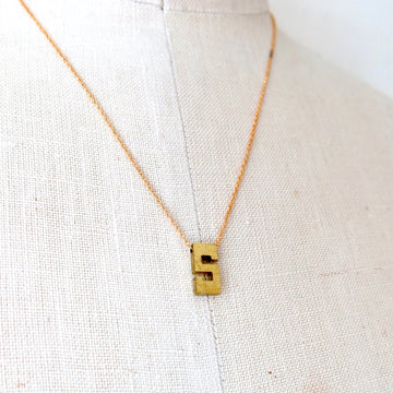 Initial Impressions Necklace by MoonRox Jewellery & Accessories is a monogram pendant floating on fine brass chain.