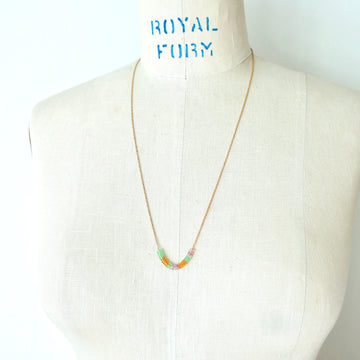 Inner Circle Necklace features a fine brass chain with a carefully arranged series of little colourful glass loops that float along the chain. Made in Toronto, Canada by MoonRox Jewellery & Accessories.