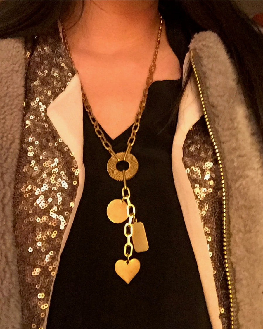 Loves Lost and Found Necklace by MoonRox Jewellery & Accessories is a brass chain lariat with charms. Shown styled with layers.