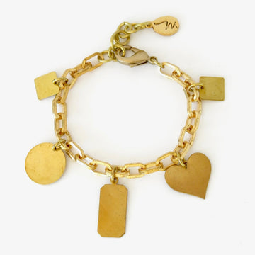 Loves Lost and Found Bracelet featuring a selection of five charms on heavy brass chain bracelet.