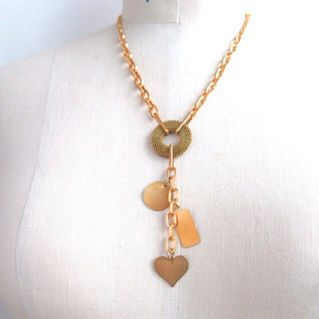 Loves Lost and Found Necklace by MoonRox is a chain lariat with 3 sweet brass charms.