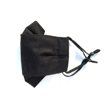 Midnight Folded Non-Surgical Reusable Fabric Mask with adjustable ear loops. Made with three layers in central panel. Plain black 100% cotton. Handmade in Toronto, Canada.