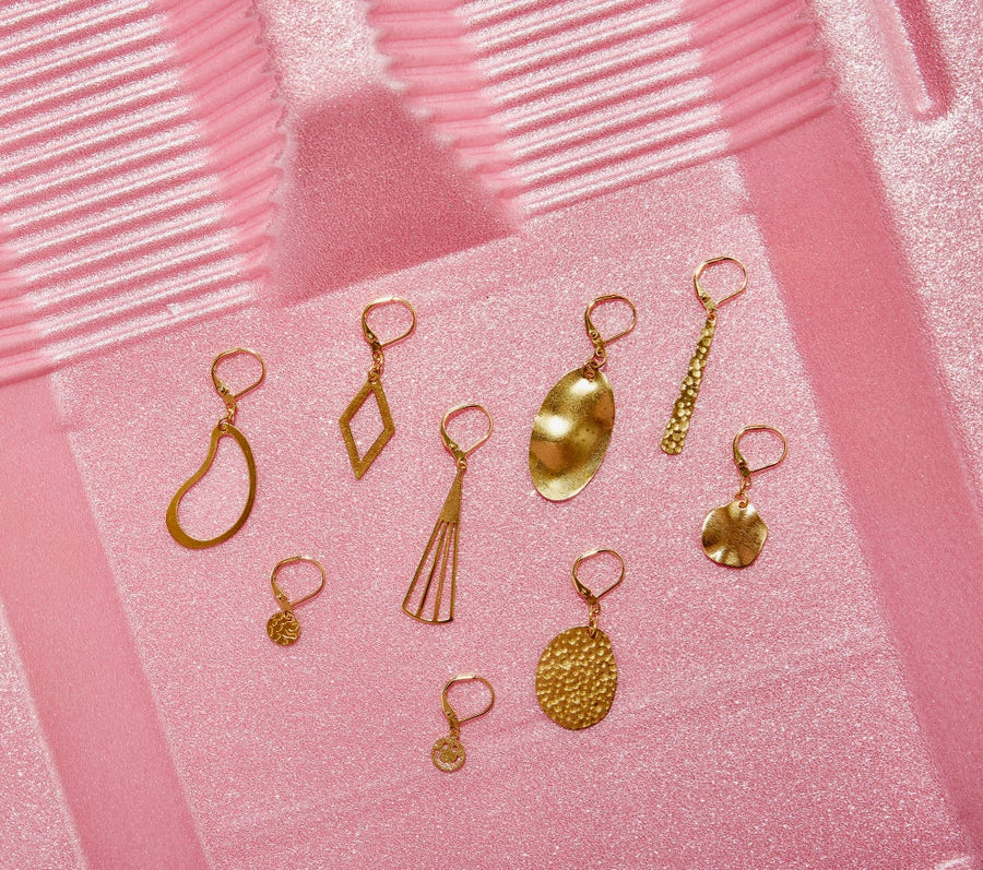 A selection of brass earrings by MoonRox Jewellery & Accessories.