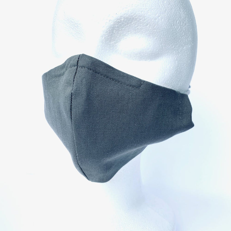 Washable fabric face covering by MoonRox in Grey cotton twill. Shown on head. Handmade in Toronto, Ontario, Canada.