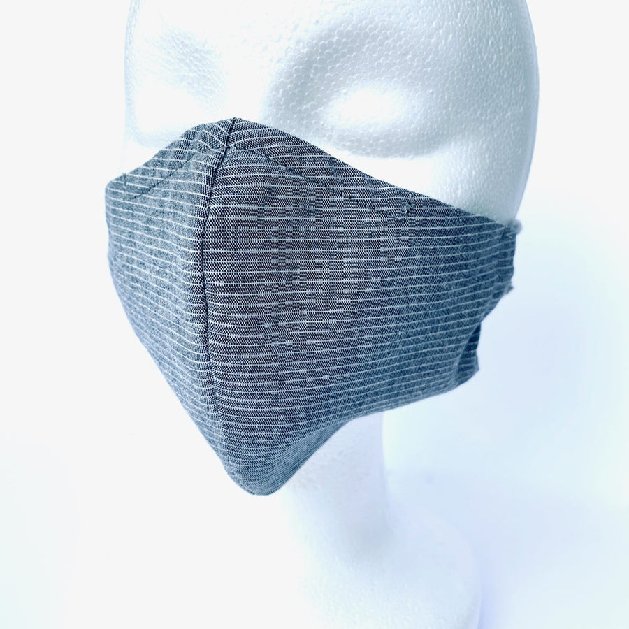 Fabric Mask in pinstripe with nose wire and soft ear loops. Shown on head. Handmade in Toronto, Ontario, Canada.