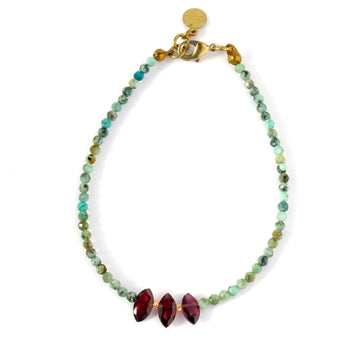 Nefertiti Bracelet by MoonRox is a beaded bracelet with African turquoise and garnet.