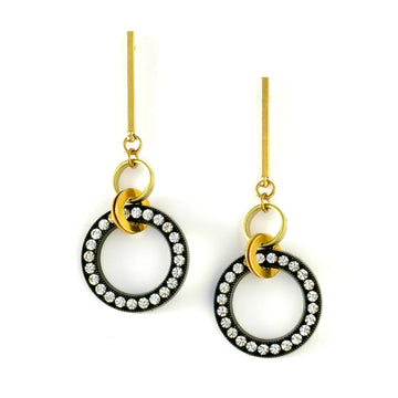 Night Sky Earrings are elongated studs with a ring of rhinestones on black base.