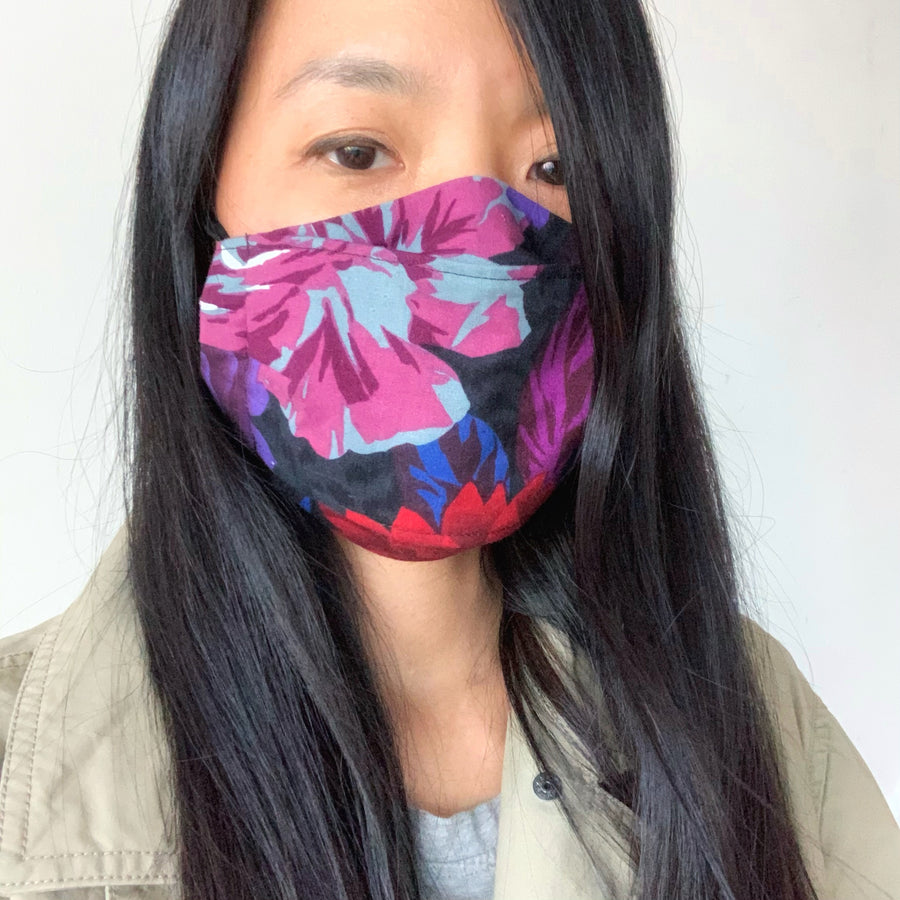 See the fit of Folded Non-Surgical Reusable Fabric Mask with adjustable ear loops. Made with three layers in central panel. Handmade in Toronto, Canada.