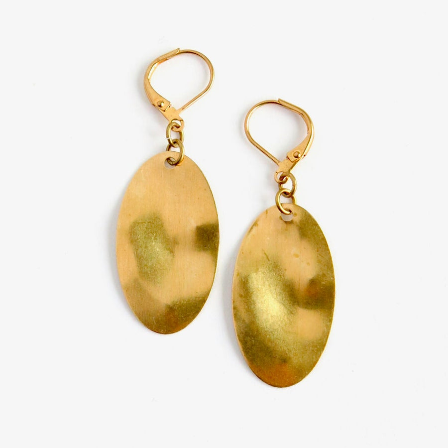 On the Same Wavelength Earrings by MoonRox Jewellery & Accessories feature oval brass charms with undulating surface.