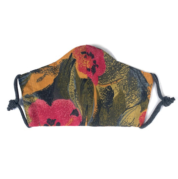 Pretty painterly floral fabric face mask. This face covering is washable and re-usable and features a filter pocket. Handmade in Toronto, Canada.