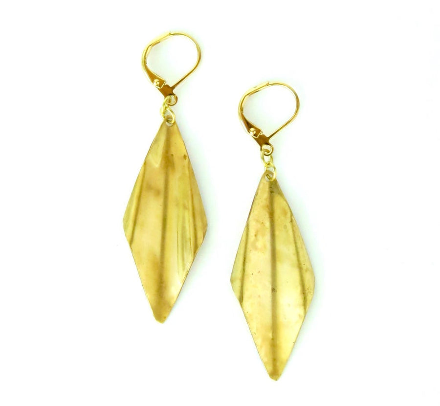 Panache Earrings by MoonRox feature a brass charm with a subtle wave.