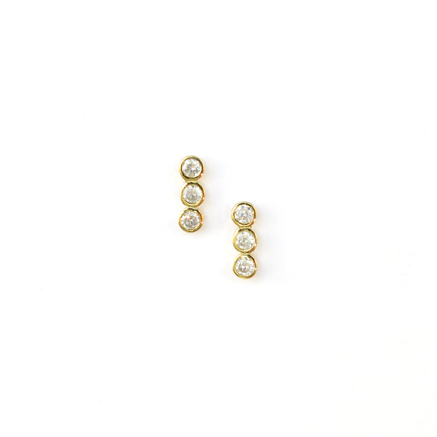 Pebble Stud Earrings feature a row of cubic zirconia stones shown in gold plated sterling silver.