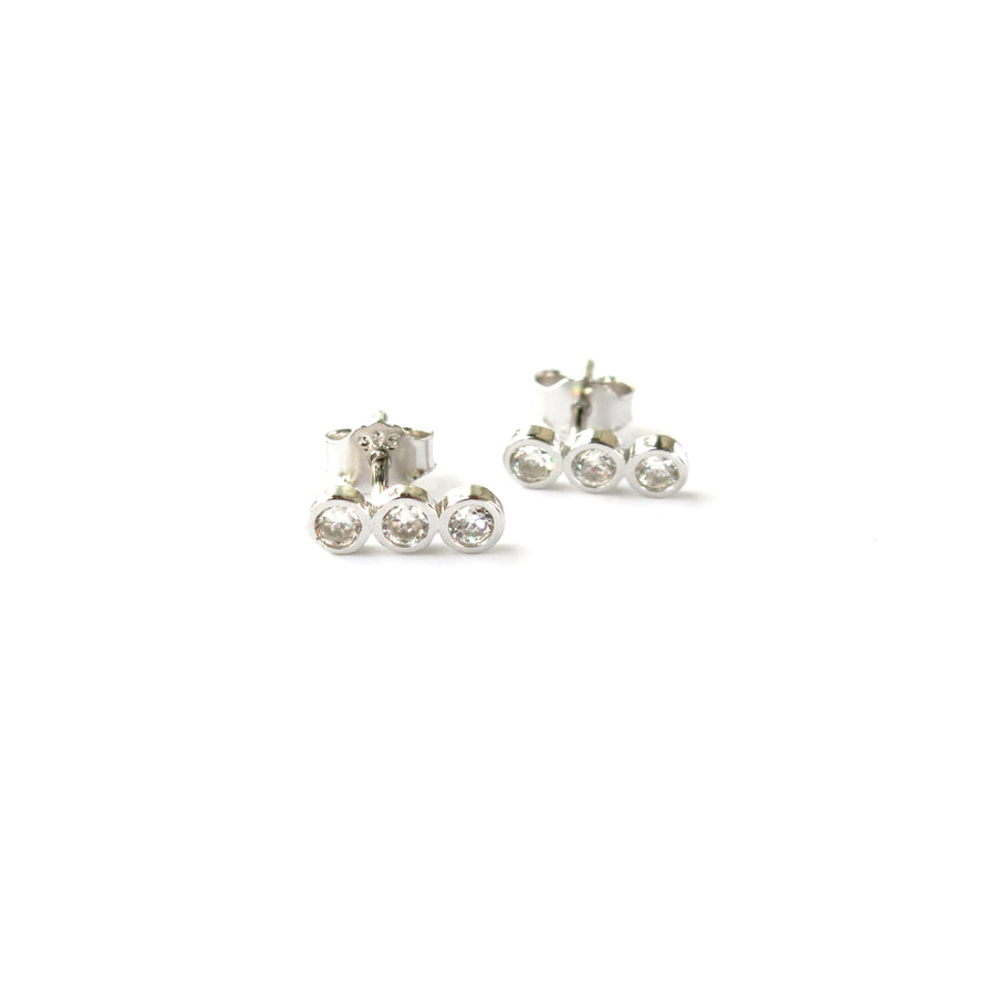 Pebble Stud Earrings feature a row of three cubic zirconia stones set in sterling silver.
