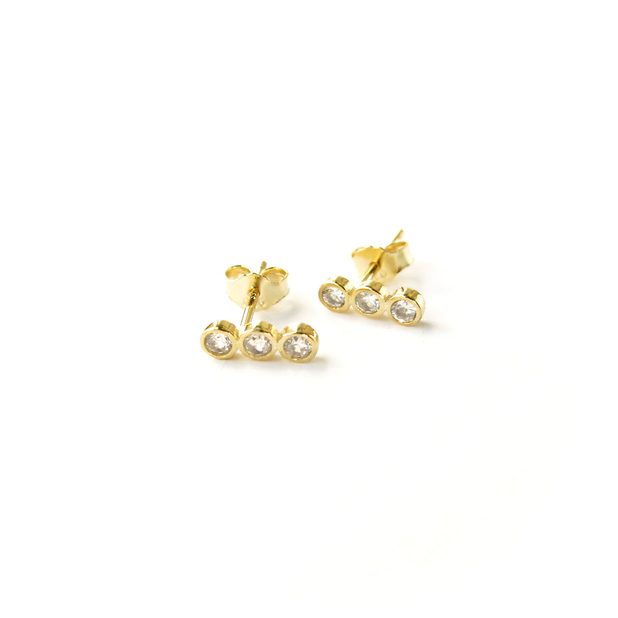 Pebble Stud Earrings feature a row of cubic zirconia stones set in gold plated sterling silver.