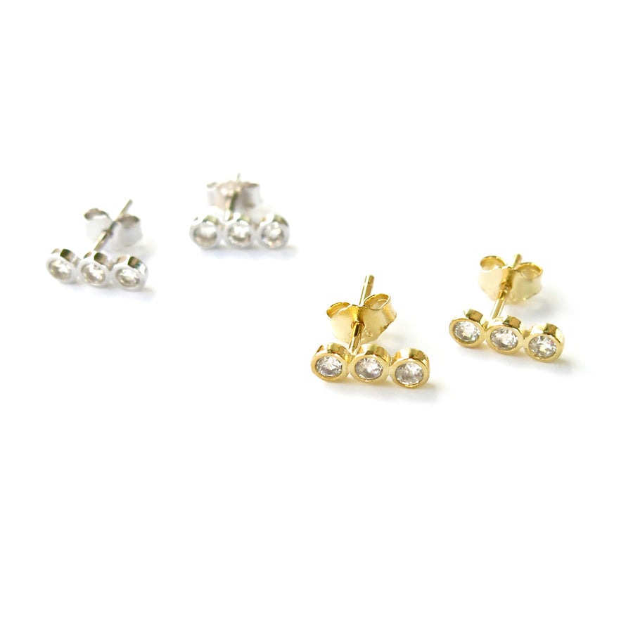Pebble Stud Earrings feature a row of cubic zirconia stones set in sterling silver or gold plated sterling silver.