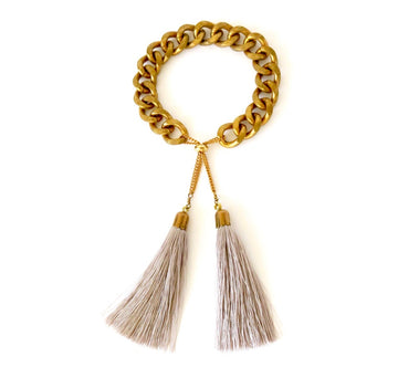 MoonRox Plume Bracelet features heavy brass chain with over sized tassel charms.