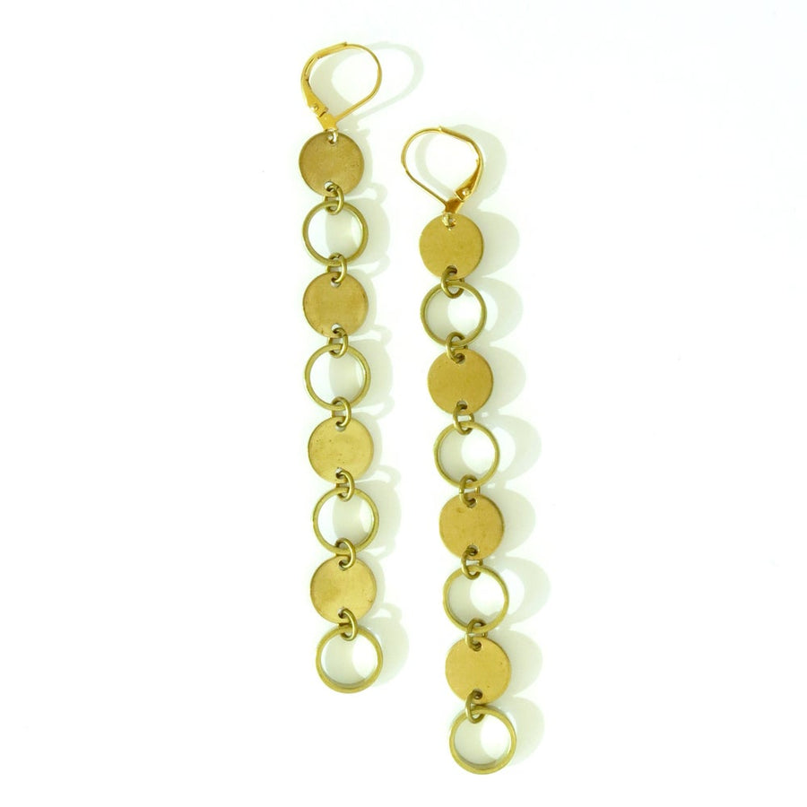 Polar Elongated Earrings are long dangly brass charm earrings with open and closed circles. Made by MoonRox Jewellery & Accessories in Toronto, Ontario, Canada.