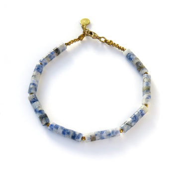 Polished Bracelets feature a combination of smooth round disc shaped beads in blue aventurine and faceted coated hematite accents.