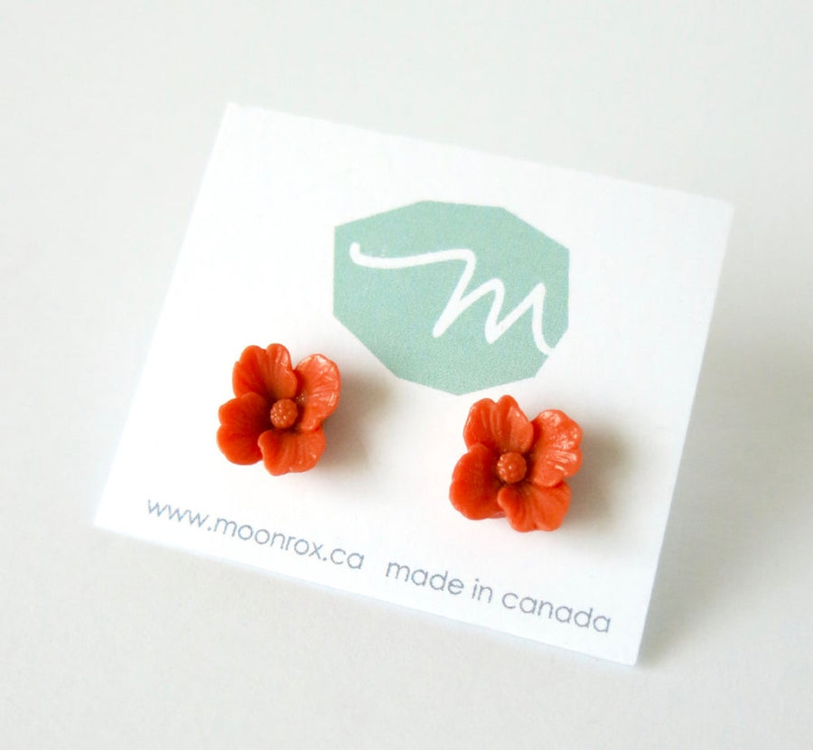 Posy Stud Earrings are pretty flower earrings made of coral coloured vintage celluloid.