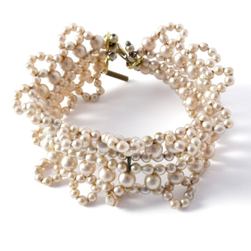 Queen Anne's Lace Bracelet is a vintage glass pearl piece that was made in Japan.
