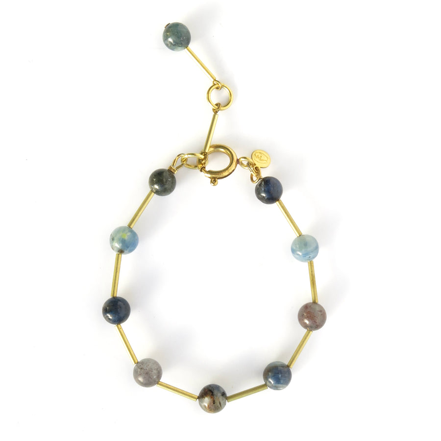 Resilience Bracelet made of round semi-precious stones staggered with brass tubes. Shown in kyanite. Made by MoonRox in Toronto, Canada.