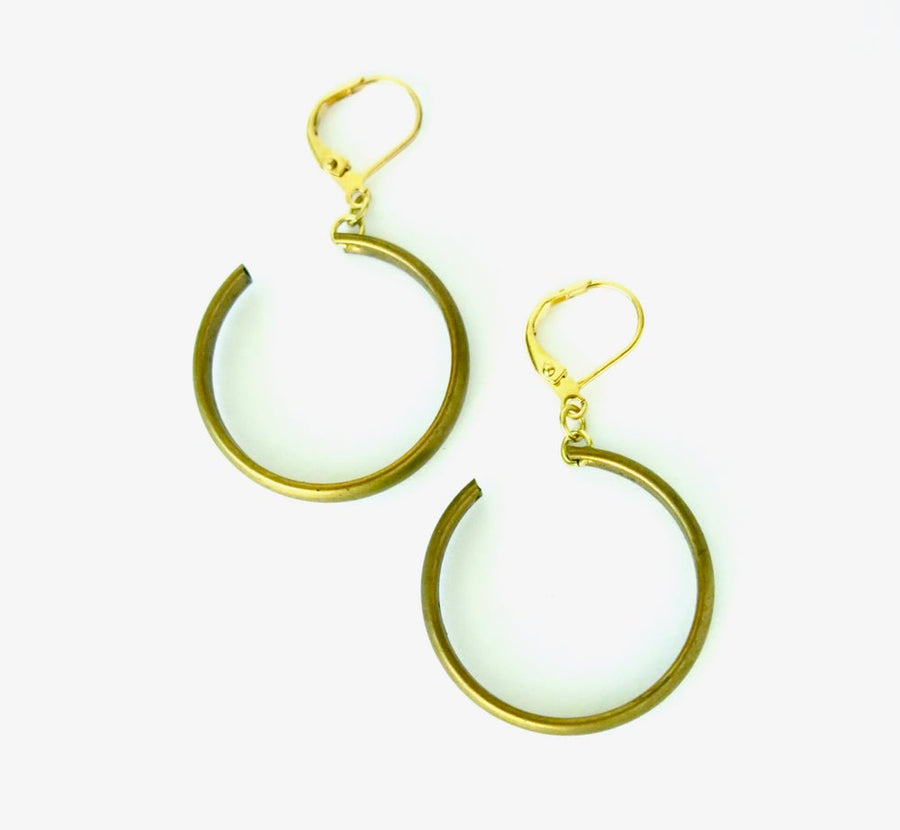 Ringlet Earrings feature a curl of brass that winds from front to back