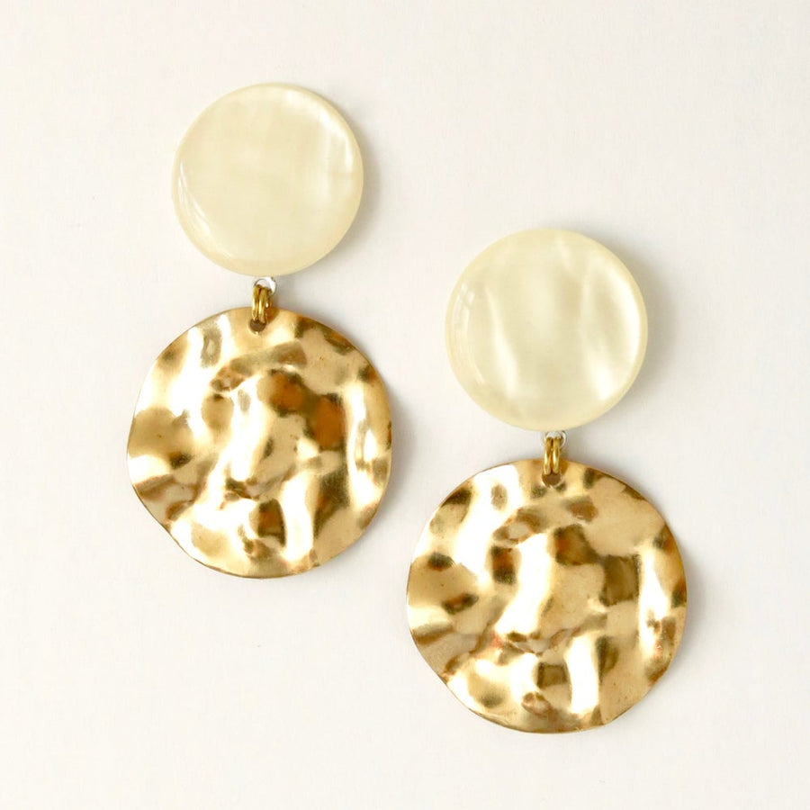 Ripple Effect Stud Earrings by MoonRox Jewellery & Accessories are mottled pearly lucite studs with large textured brass charm suspended below.