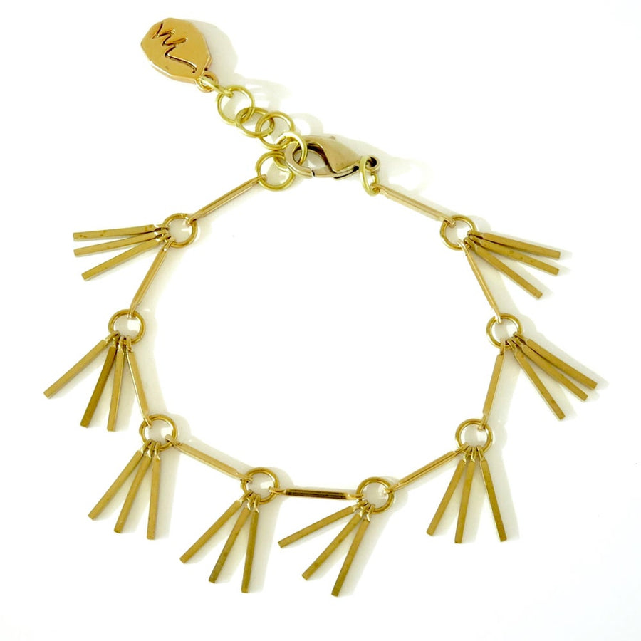 Rising Phoenix Bracelet is delicate brass piece with winged details.