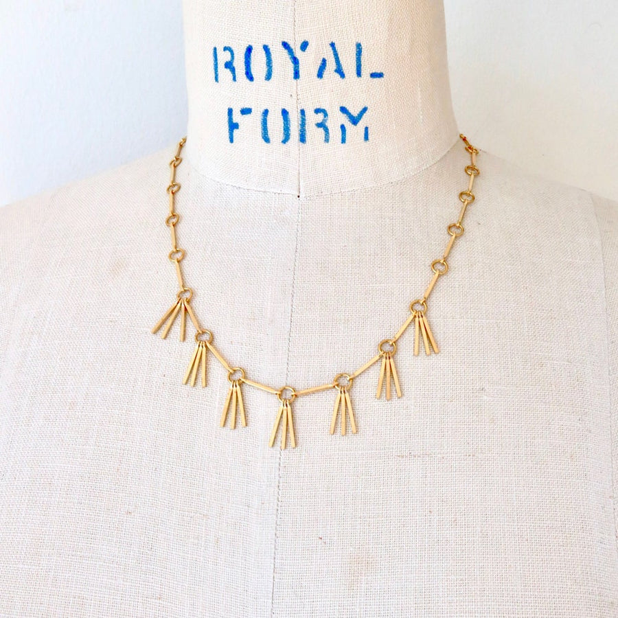 Rising Phoenix Necklace by MoonRox Jewellery & Accessories features linear components and brass fringe.