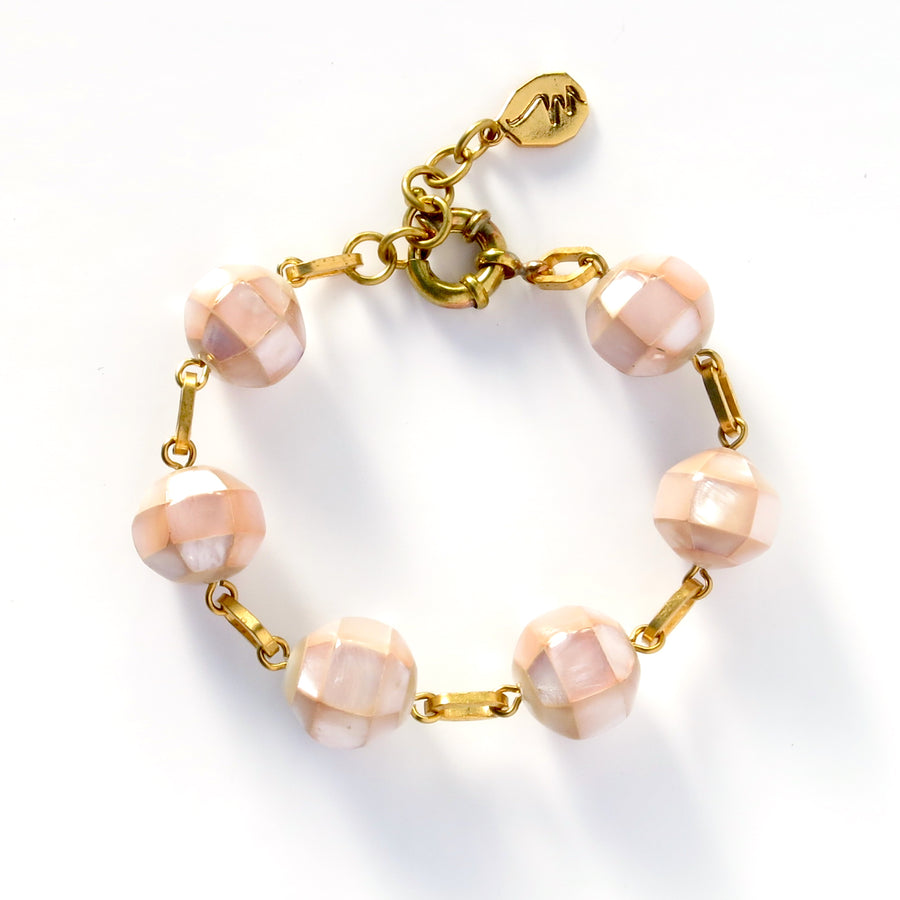 Rosa Bracelet with faceted mother of pearl beads in soft pink are hand wired together with brass links