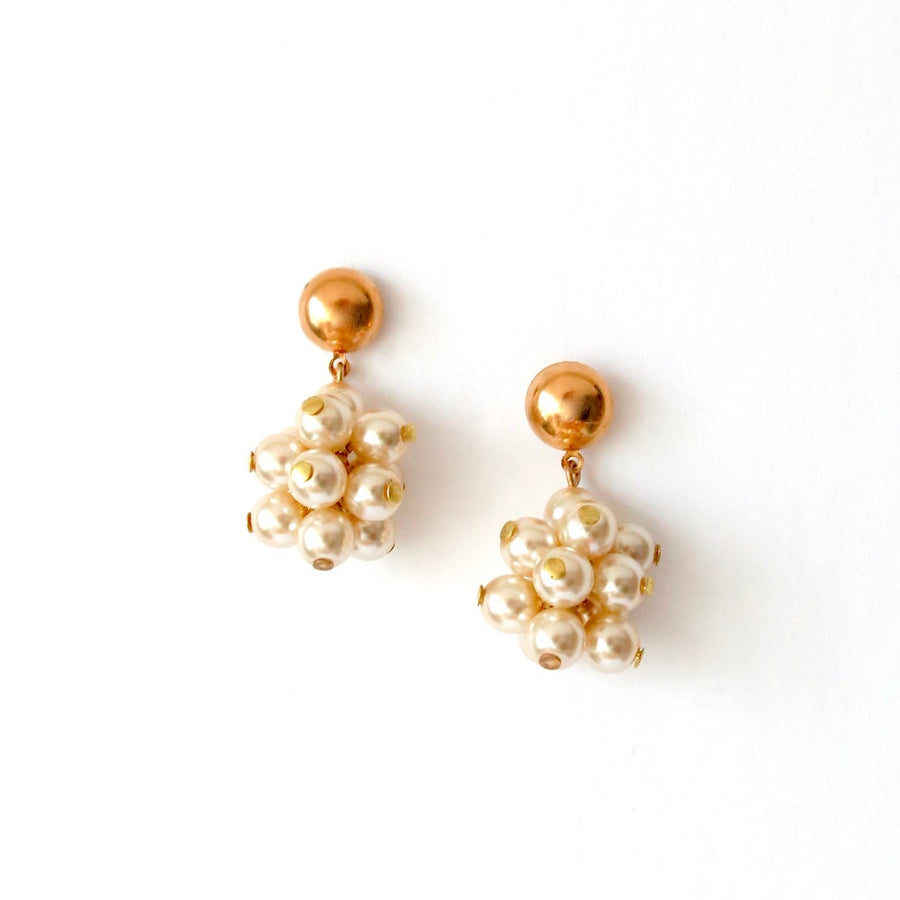 Clusters of glass pearls dangle from stud earrings.