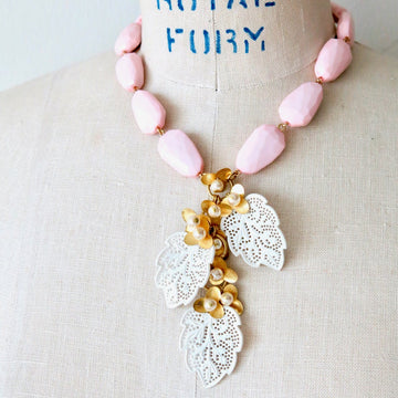 Secret Garden Necklace by MoonRox Jewellery & Accessories - This necklace is made of vintage faceted pink beads with cascading brass and pearl flowers with delicate vintage celluloid lace leaves.
