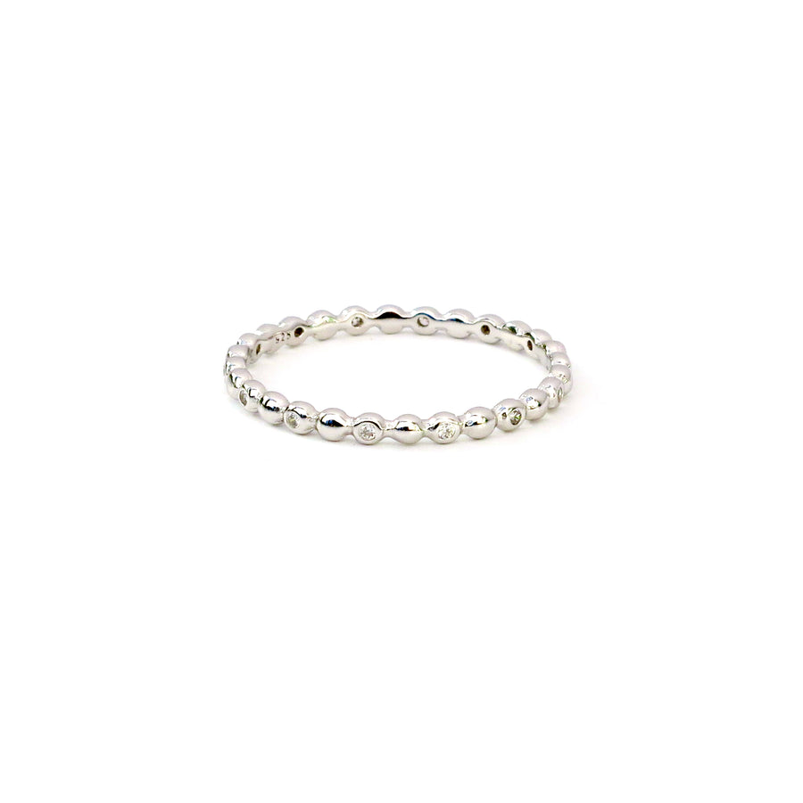 Seed Ring is a sterling silver ring with a row of little pods and cubic zirconia stones along the band.