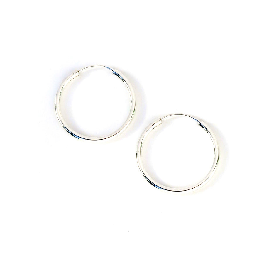 Simple Hoop Earrings are classic sterling silver hoops.