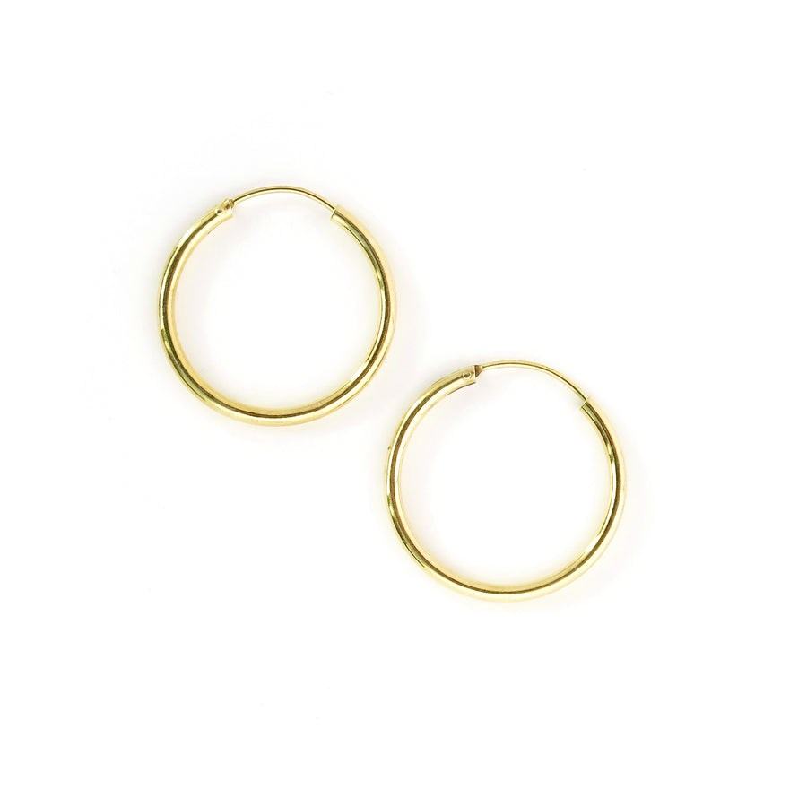 Simple Hoop Earrings are classic sterling silver hoops. These are gold plated.