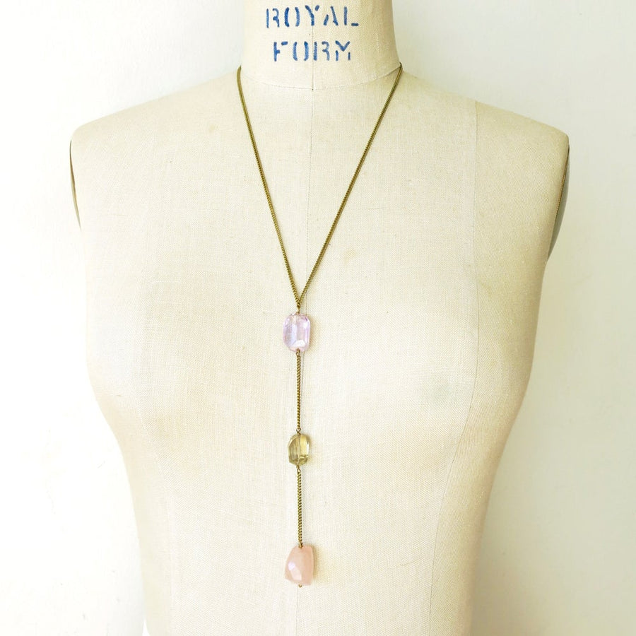 Skipping Stones Necklace is a Y-style lariat with three lovely and substantial semi-precious stones. This Necklace features amethyst, lemon quartz and rose quartz stones.