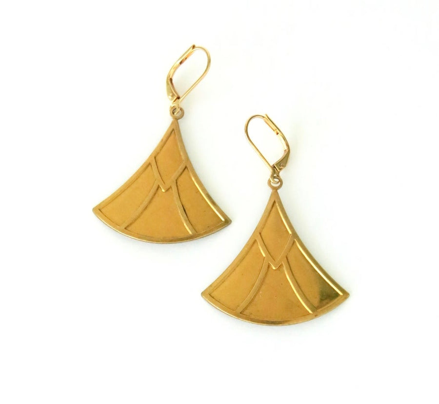 Strobe Earrings with three sided brass charms that swell at the base.