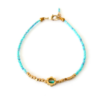 Surfside Bracelet by MoonRox - Dainty bracelet with turquoise beads with brass flower centrepiece.
