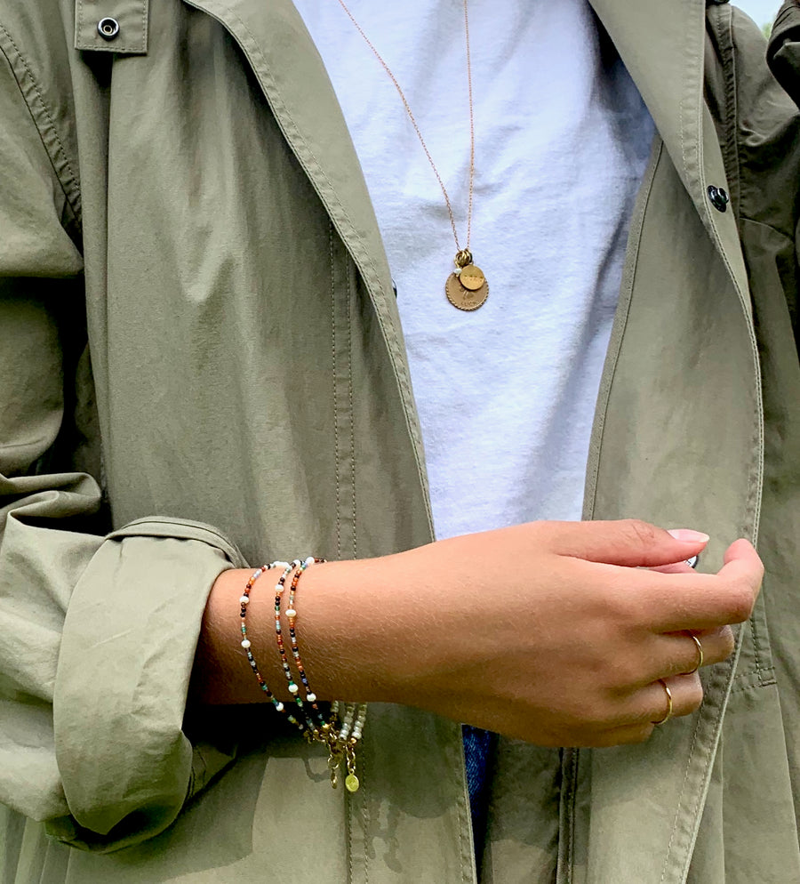 Fine Line Ring is a simple thin gold plated sterling silver band. Styled with Meridian Bracelets and Token Necklace from MoonRox Jewellery & Accessories.