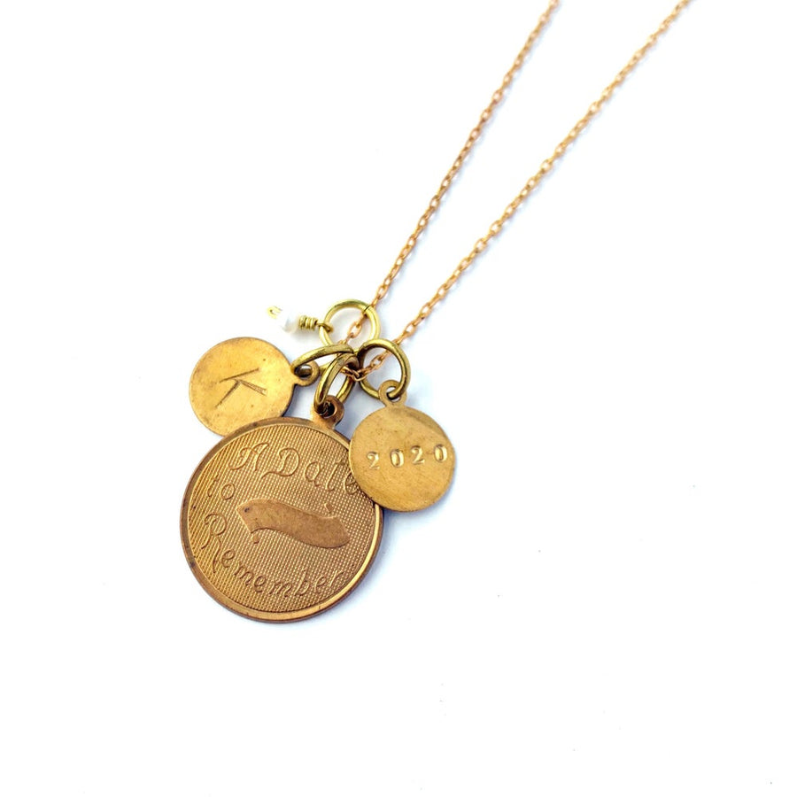 Token Necklace by MoonRox - Charm necklace with assorted coin shaped charms including one that says